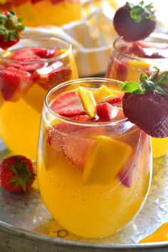 This Strawberry Mango Sangria combines so many summer favorites in one delicious drink! Perfect for parties, ladies' nights, or lazy summer weekends, this sangria is destined to become your new go-to drink! Mango Sangria, Sangria Drink, Apple Sangria, White Wine Sangria, Rose Sangria, Girls Luncheon, Luncheon Menu, Sangria Recipes, Fruit Recipes