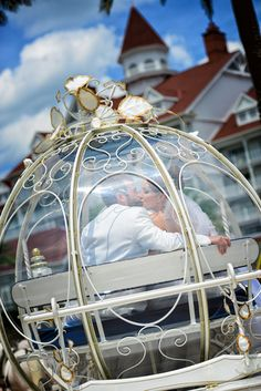 Happily ever after kisses in Cinderella's Coach. Photo: Beth, Disney Fine Art Photography