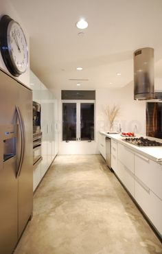 Cement floor in a tan/beige finish: perfect flooring for kitchen area