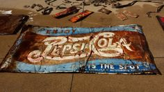 Pepsi Cola sign after being cleaned up from being on a barn roof since the late 1930's.  Great patina and colors!