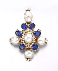 A BAROQUE CULTURED PEARL, SAPPHIRE AND DIAMOND BROOCH, BY HARRY WINSTON   Centering upon a baroque cultured pearl, within a circular-cut diamond surround, extending oval and cushion-cut sapphires and circular-cut diamonds, enhanced at the cardinal points with baroque cultured pearls and diamonds, mounted in 18k gold, circa 1979, (with pendant hoop for suspension), in a Harry Winston black suede case  With maker's mark for Harry Winston