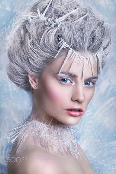 Snow Queen, creative closeup portrait. Young woman - Snow Queen, creative closeup portrait. Young woman in creative image with silver artistic make-up. Winter Portrait.