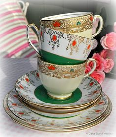 art deco cream, gold and green teacups and saucers
