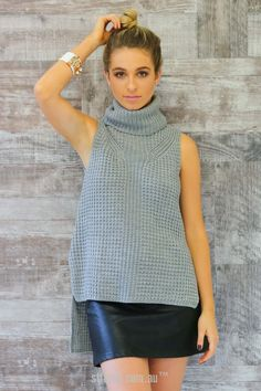 Take A Stand Turtle Neck Sleeveless Top in Grey $49.90 The Take A Stand Sleeveless Turtle Neck will bring high fashion right to your wardrobe – it's a sleeveless, waffle knit sweater top with a turtle neck. This piece features a hi-lo hemline which adds to the edginess. To style this piece to perfection, you'll need faux leather bottoms and some fabulous jewellery to jazz up the neckline.