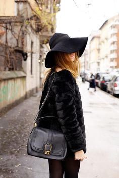 black, fur, floppy hat.