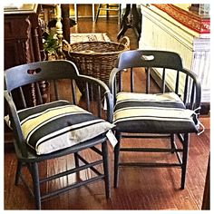 Saloon chairs painted with Annie Sloan Chalk Paint® using the color graphite. Pillows covered in Paris Noir et Lin Ticking fabric