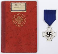 "Lot 375: World War II German Civilian Medal and Booklet; Including a 1935, DAF Membership Book ""die deutsch arbeitsfront"" (the German labor front) and a ""fur treue dienste"" (for faithful service) medal"