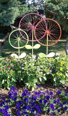 Before taking that old bike to the junkyard, consider this garden ornament idea from The Hanky Dress Lady: Bicycle Wheel Garden Art - Steel Magnolias. -Garden Ornaments- #GardenArt