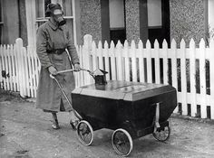Woman-With-A-Gas-Resistant-Pram-England-1938