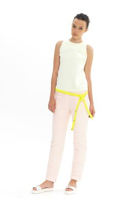 Light pink and white outfit with a pop of yellow by Dori Tomcsany