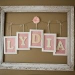 Frame around letters spelling the baby's name on the wall.