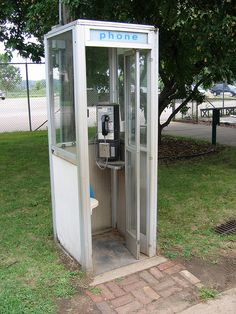 Phone booth. A place to sit, a door to close, and usually an intact phone book, as well!