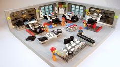 "brickadelics: ""Police Customization Shop - where stock cars become police cars! by LEGO Police Force on Flickr. """