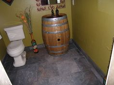 Wine barrel sink! Basement bathroom, I think so. I wonder if I can get the barrel full of wine and drink it first.