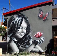 by DEM (LP). Street Art, Mural. Happy girl with pink butterflies.