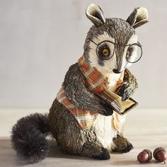 Bespectacled and wearing a plaid vest, Professor Raccoon takes his literary pursuits quite seriously. But don't think for a second that he's left his mischievous side behind. Come fall, he could forgo his book in favor of creating some nocturnal indoor adventure.
