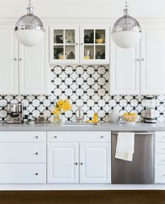 Modern graphic tiling and fixtures create a contemporary culinary feel. | http://domino.com