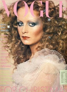 Twiggy surrounded by stars. Vogue Magazine, December, 1974.