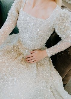 A behind the scenes photo of our Ellis during our Denver, Colorado trunk show! Ellis features sparkle all over that creates a mineral effect, detachable long sleeves and an elegant squared neckline. Modest made to measure wedding gowns for the couture bride. #ChanaMarelus #ElegantBridal #couture #fashion #bridal #bridalfashion #bridalcouture #hautecouture #modernbride #classicbridal #modestbridal #modestweddingdress #lacegown #Brides #JewishBride #JewishDesigner #IsraeliBridal Rustic Wedding Dresses, Beautiful Wedding Gowns, Dream Wedding Dresses, Bridal Dresses, Beautiful Dresses, Weeding Dress, Wedding Dress Sleeves, Evening Gown With Sleeves, Gossip Girl