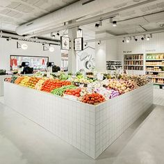 Casa Nostra Fruit Shop's new image focuses on raising the product's attention above everything. An interior design that avoids stereotypes, that has been applied uniquely monochrome in a space that does not need decorative elements, and that highlights its fresh and colourful products. ⠀  ⠀  Photo by Maria Pujol⠀  ⠀  @miriam.barrio ⠀  ⠀  #architonic #architecture #interiors