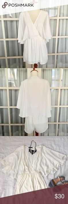 Off White Flowy Romper In great condition Off White Eggshell Romper by Honey Punch in size S small. Features includes cape like back style, flowy material, V neck line, stretchy waist, and high quality material. You will definitely receive compliments! Easy to dress up or down. Very flattering and great for date night or night out with the girls. Bundle deals and prices available.  Check my closet for great jewelry, Forever 22, Express, and other great items! Honey Punch Dresses Mini