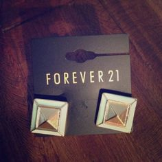 Stud earrings **FREE** Gold studs with Tiffany blue border. Square shape with gold pyramid in middle. Never worn, comes with backs! 😊 not sure of original price because they were a gift and the price tag is torn. Must go- FREE WITH ANY PURCHASE -just mention at time of purchase! Forever 21 Jewelry Earrings