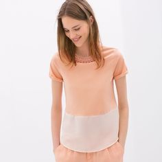 Zara combined top with necklace Classy tee with necklace detail. Top is gorgeous light coral and bottom hem area is semi-sheer chiffon material. In very good condition. Zara Tops Tees - Short Sleeve