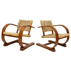 A Pair of Bentwood and Rope Armchairs by Audoux Minet for Vibo Vesoul | From a unique collection of antique and modern armchairs at http://www.1stdibs.com/furniture/seating/armchairs/