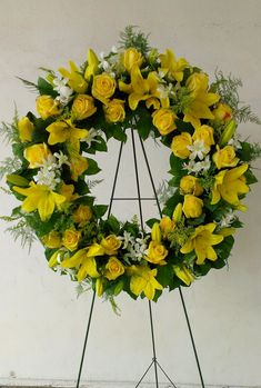 Yellow Funeral Wreath with roses, lilies and dendrobium orchids.