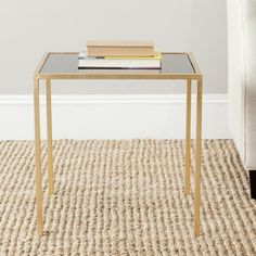 Sophisticated style is often the most simple. Crafted with a gold-leaf iron base and black glass tabletop,the Kiley accent table's demure style brings instant …