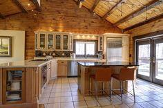 Rustic Kitchen With Pebble Rock Quartz Countertop, Linda Stool, Absolute  Black Granite, Veranda Solids Porcelain Tile