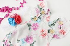 Adorable floral sitter session baby romper from birdie baby boutique #easter #spring #photography #sittersession