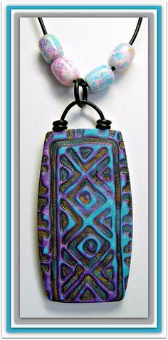 Polymer Clay Mokume Gane Pendant, via Flickr.