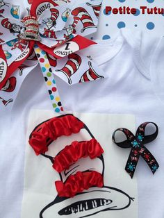 Dr Seuss inspired cat in the hat satin ruffled onesie with coordinating pinwheel bow