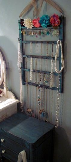 Crib rail repurposed into a jewelry organizer.  Brilliant!  Great thing to use those cribs at thrift stores or garage sales for that probably don't meet today's safety standards.
