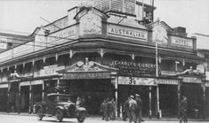Australian Hotel, corner of Queen St and Albert St, Brisbane, 1942 - Photograph taken outside the Australian Hotel during World War II. You can see servicemen outside the hotel crossing the street.