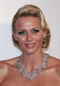 Princess Charlene of Monaco, the necklace, with converts into a tiara, has a wave motif that celebrates her love of swimming