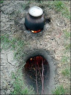 the three stones are used to keep the cooking pot off the top of the single cinder block ...you can see them if you look carefully at the finished diagram.  the plains Indians in North America (the Dakota being one of the tribes to do so) used these stoves: