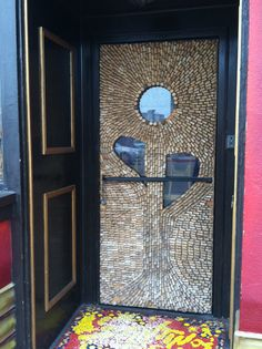 Something for heavy wine drinkers: a door decorated with wine corks (Santino's Pizza in Venice, CA)