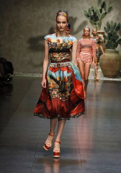 Dolce & Gabbana Women Fashion Show Gallery – Spring Summer 2013 Collection - The photos of Dolce & Gabbana Woman Fashion Show Spring Summer 2013 inspired by the most profound Sicilian Tradition:prints with the puppets of Sicilian street theaters, typical local barrows and the Caltagirone head-shaped ceramic vases and dishes.