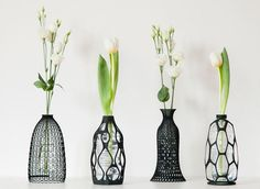 The 3-D printed lattice can be screwed on like a bottle cap, transforming water bottles into lovely decorative objects.