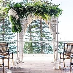 This beach #venue in Australia has sweeping ocean views. Macrame ceremony arch perfect for a bohemian wedding.  Floral Design: @floraflk | Arch: @littlelaneevents | Photo: Carlos Waters