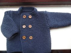 Hand knitted baby boys jacket