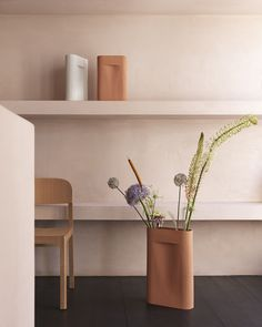 Modern and sculptural home decor accessories inspiration from Muuto: The Ridge Vase presents a new way to display flowers through its sculptural expression along with an artful character when not in use. The design features added functionality through its refined dent, allowing flowers to stand upright while also working as a subtle handle when moving the vase from one room to another. #scandinaviandesign #homedecor