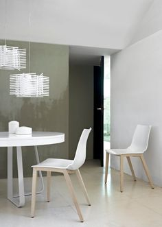 PAOLA Chair; Claudio Dondoli & Marco Pocci. Base in natural satin varnished solid ash. Seat/back in reinforced techno polymer – white. Set of two chairs. H81 W46 D53.5 CM  Live Beautifully! www.lignerosetsf.com