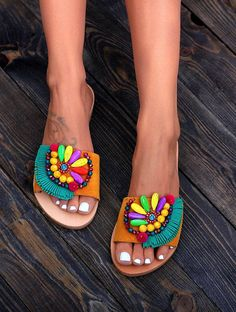 Handmade genuine greek leather sandals. Slides sandals handcrafted in Greece with a rubber sole, leather upper sole and a leather strap. The leather strap is coverd with a mustard yellow suede strap. We embellish the sandals with Preciosa crystals, green suede tassels, agate