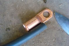 Properly crimping a copper welding lug.