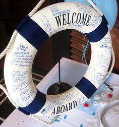 "life preserver ""guest book"" for nautical theme wedding. Instead of ""welcome aboard,"" it could have the couple's name and date. Perfect for @Gentry Coats Coats Coats Adams!!"