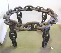 Circular antique iron nautical chain link table made entirely of vintage wrought iron chains salvaged from the Staten Island Ferry in New York City. This unique piece would make a fine coffee table. All it needs is a top, normally glass, but marble would look awesome!