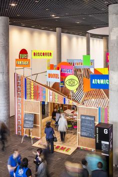 Neon words and symbols embellish the exterior of this temporary wooden pavilion inside the new Library of Birmingham by designers Morag Myerscough and Luke Morgan.
